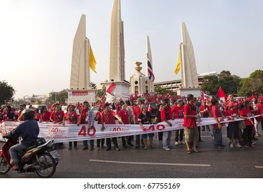 BANGKOK - DECEMBER 10: Thousands of Thailand's Red Shirts protest at Democracy Monument against the government and current military drafted constitution on December 10, 2010 in Bangkok, Thailand.
