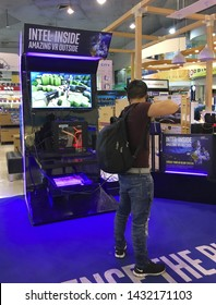 BANGKOK - DECEMBER 12, 2017: An unidentified man plays a VR archery game in Pantip Plaza. The man uses a VR system of Intel processors, an HTC Vive headset and two wireless handheld controllers