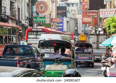 BANGKOK - DECEMBER 12: Yaowarat Road in Chinatown with unidentified people on December 12, 2014 in Bangkok. It is the main street in Chinatown built by King Rama V and a famous tourist attraction