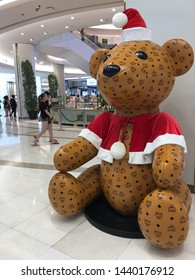 BANGKOK - DECEMBER 13, 2017: A big bear in a Santa Claus dress covered with MCM logos in Siam Paragon mall. MCM Worldwide is a leather luxury goods brand founded owned by Sungjoo Group.