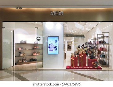 BANGKOK - DECEMBER 13, 2017: An MCM store in Siam Paragon Shopping mall. MCM Worldwide is a leather luxury goods brand founded by Michael Cromer and bought out by Sungjoo Group in 2005.