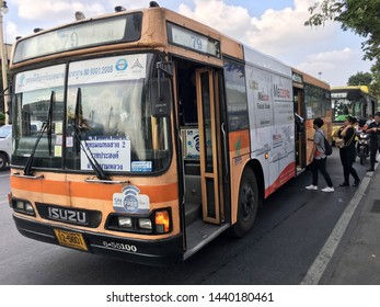 BANGKOK - DECEMBER 13, 2017: Unidentified people get on bus 79 at Ratchadamnoen (Bangkok city library) bus stop. Transport in Thailand is varied and chaotic, with no one dominant means of transport.