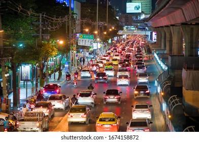 BANGKOK - DECEMBER 16, 2019: City traffic at night with crowded road.