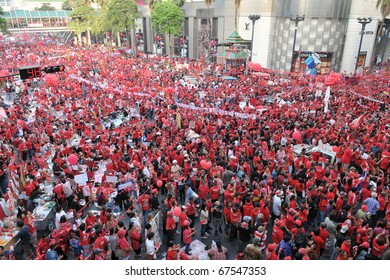 BANGKOK - DECEMBER 19: An estimated 10,000 anti government Red Shirts defy an emergency decree to protest at Rachaprasong junction on December 19, 2010 in Bangkok, Thailand.