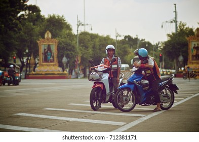 Bangkok- December 2016: Two-motercycle taxi are parking on the road near the grand palace in the center of Bangkok December 2016.