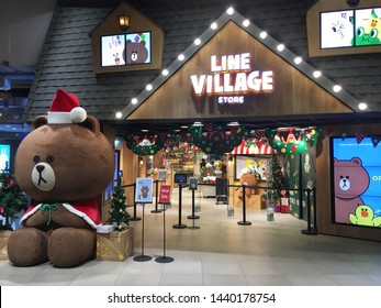 BANGKOK - DECEMBER 2017: Line Village store with big bear Brown in Santa Claus's dress in the Siam Paragon mall. Line (styled as LINE) is freeware app for instant communications on electronic devices