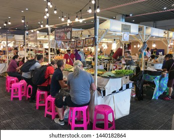 BANGKOK - DECEMBER 2017: People eat at a food court by MBK Center. It is a large shopping mall that was the largest one in Asia when it opened in 1985. More than 100,000 people visit it daily.