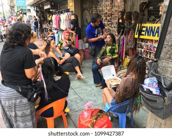 BANGKOK - DECEMBER 2017: Unidentified men and women make dreadlocks for young people in Khao San Road. It is called the centre of the backpackers universe.