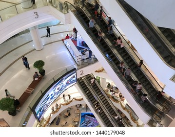 BANGKOK - DECEMBER 2017: Unidentified people walk and move on escalators inside the Siam Paragon Shopping mall. It is one of the biggest shopping centres in Asia.
