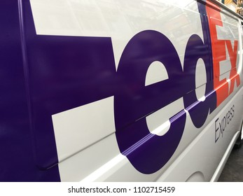 BANGKOK - DECEMBER 2017: A van of FedEx in the city center. FedEx Corporation is an American multinational courier delivery services company headquartered in Memphis, Tennessee