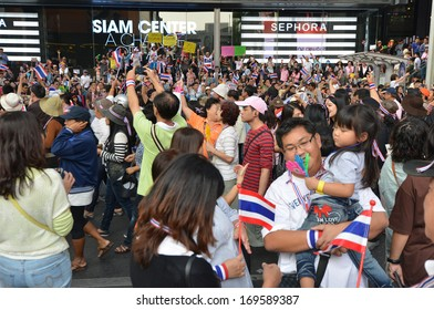 BANGKOK - DECEMBER 22: Thai people protest against corruption of the Thaksin government at Central Siam area on December 22, 2013 in Bangkok, Thailand.