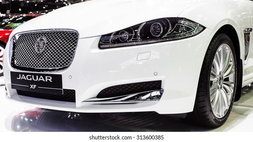 Bangkok - December 28 : headlights of  white Jaguar series V8 supercharge - in display at Thailand international motor expo 2014 on December 28, 2014 in Bangkok Thailand