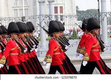 BANGKOK - DECEMBER 5 : A row of Thai royal guard military march during the king's birthday parade on Dec 5 ,2012 in Bangkok ,Thailand