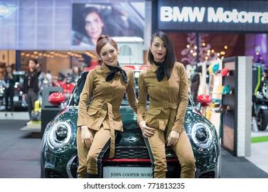 BANGKOK - December 7, 2017 : Unidentified model with Mini car on display at The Bangkok International Motor Expo 2017 on December 7, 2017 in Bangkok, Thailand.