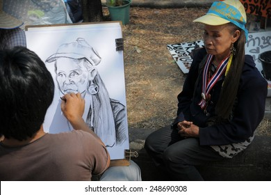 BANGKOK - FEB 11: An artist draws a portrait of a nationalist Yellow Shirt supporter at a rally outside Government House on Feb 11, 2011 in Bangkok, Thailand. The protesters are opposed to elections.