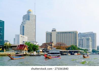 BANGKOK, - FEB 17: Some pleasure boats sail on Chao Phraya river near SSumption College, Feb 17, 2013, Bangkok, Thailand. Bangkok is nicknamed Asian Venice due to developed river transportation.