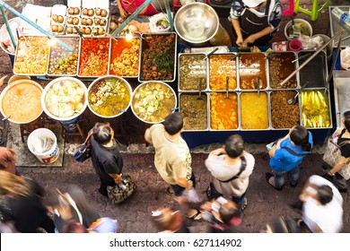 BANGKOK - FEB 20: Unidentified vendors prepare food at a street side restaurant on Feb 20, 2017 in Bangkok, Thailand. Government figures indicate about 12,000 registered street vendors in Bangkok.