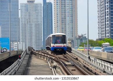 BANGKOK - FEB 6 : BTS Skytrain crossing Taksin Bridge and arriving the station BTS (Bangkok mass transit system) on February 6, 2019 in Saphan Taksin Station, Bang Rak, Bangkok, Thailand