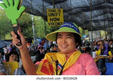 BANGKOK - FEB 8: An unidentified yellow-shirt protester at a large anti-government rally outside Government House Feb 8, 2011 in Bangkok, Thailand.