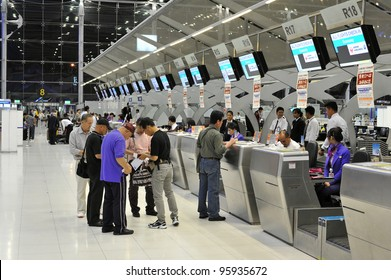 BANGKOK - FEB 9: Unidentified passengers arrive at the check-in counters at the new Suvarnabhumi Airport, Feb 9, 2012 in Bangkok, Thailand. The airport is one of the busiest in Asia, handling about 45 million passengers annually.