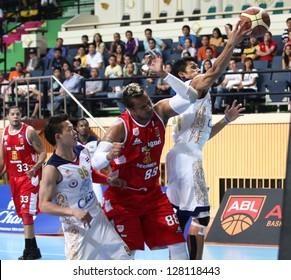 "BANGKOK - FEB13:Pauliasi Taulava #88 of San Miguel Beermen participates in an ASEAN Basketball League ""ABL"" at Nimitbut Stadium on February 13, 2013 in Bangkok,Thailand.SMB beat CTS 77-73"