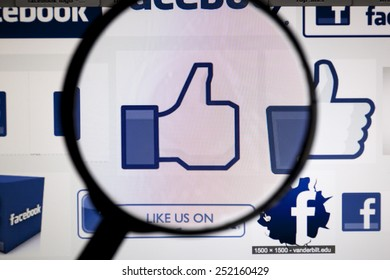 BANGKOK, FEBRUARY 13, 2015: Facebook's Likes being magnified. Facebook is an online social networking service headquartered in Menlo Park, California.