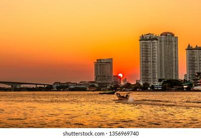 Bangkok, February 22,2019: Sun set view  In the Chao Phraya River of Thailand.