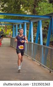 BANGKOK - FEBRUARY 9 : Unidentified mini marathon runner at TG Run Smooth As Silk 2019, charity run for children and youth, on February 9, 2019 Bangkok, Thailand.