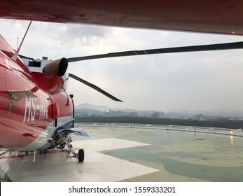 Bangkok Hospital, Hatyai, Thailand, November 14, 2019: Helicopter Emergency Medical Service. medical transport helicopter or Offshore Transport Helicopter on hospital rooftop. Sikorsky helicopter