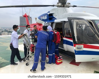 Bangkok Hospital,Songkla, Hatyai, Thailand, November 14,2019: Offshore Helicopter Emergency Medical or helicopter medical evacuation. Transport patient from offshore to hospital rooftop emergency pad.