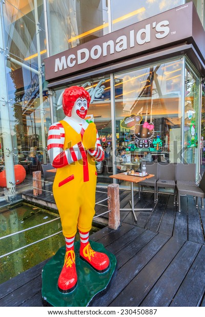 BANGKOK - JAN 11: McDonal's character at Esplanaded on Jan 11, 2014 in Bangkok. It is the world's largest chain of hamburger fast food restaurants, serving around 68 million customers daily.