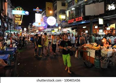 BANGKOK - JAN 15, 2012: Unidentified tourists walk along backpacker haven Khao San Road. Budget accommodation on Khao San Road starts from $6 or B200 per night.