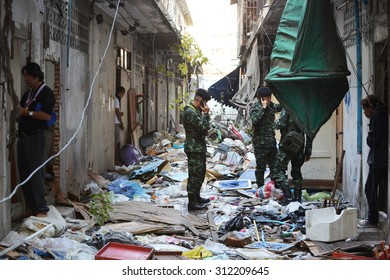 BANGKOK - JAN 17: Soldiers search derelict buildings following a bomb attack on anti government rally on Jan 17,  2014 in Bangkok, Thailand. One protester died in the bombing and dozens were injured.