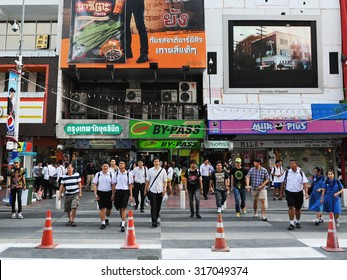 BANGKOK - JAN 24: People cross a street at Siam Square on Jan 24, 2013 in Bangkok, Thailand. Siam Square is a shopping and entertainment area and sometimes referred to as Thailand's Shinjuku or Soho.