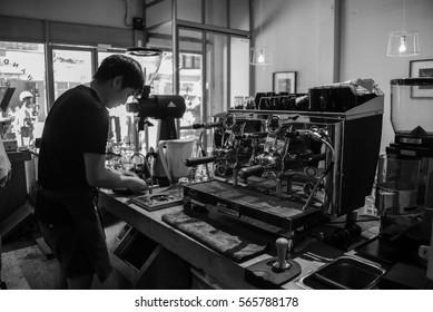 Bangkok - Jan 27, 2017 - Barista preparing cup of coffee for customer in coffee shop.