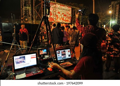 BANGKOK - JAN 29: An unidentified video editor operates an editing system during a large city center red-shirt rally on Jan 29, 2013 in Bangkok, Thailand.