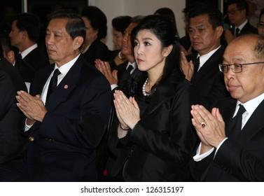 BANGKOK - JAN 29:Yingluck Shinawatra (Thailand Prime Minister) attend the funeral Chumphon Sinlapa-a-cha at Thepsirin temple on January 29, 2013 in Bangkok,Thailand