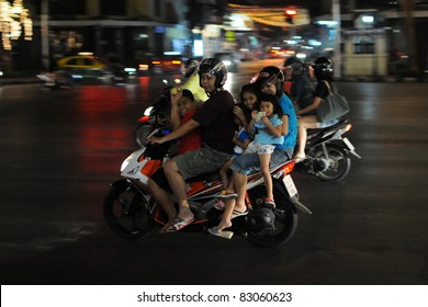 BANGKOK - JAN 3: Unidentified family of six on a motorbike in the Thai capital Jan 3, 2011 in Bangkok, Thailand. The use of motorbikes as family transport is commonplace throughout much of Thailand.