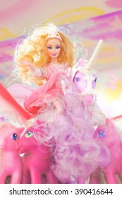 BANGKOK - Jan 9, 2016 : Barbie on Unicorn surrounding with ponies from My Little Pony for display. Barbie is a fashion doll manufactured by the American toy-company Mattel and launched in March 1959.