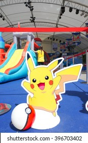 BANGKOK - Jan 9, 2016 : Photo of Pocket ball & Pikachu Di-cut for Photo booth on Pokemon Day Event in outdoor tent at Siam Paragon, organised for Children's day in Thailand.Texture of carpet not noise