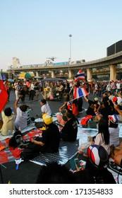 BANGKOK - JANUARY 13 2014 : Thai protestors attempt to topple government with Bangkok shutdown at Victory Monument in Bangkok, Thailand
