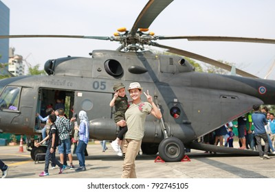 BANGKOK - JANUARY 13 :Children's day, Unidentified people and childrens taking photo with helicopters at Royal Thai Army Headquarters on January 13, 2018 in Bangkok Thailand.