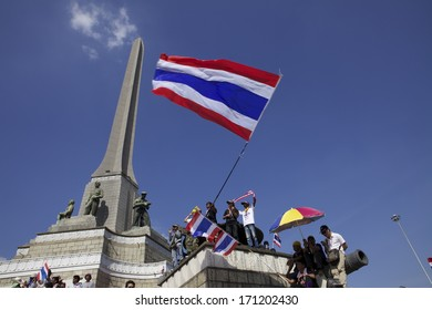 BANGKOK - JANUARY 13 : Protesters against the government rally together near Victory Monument on January 13, 2014 in Bangkok, Thailand