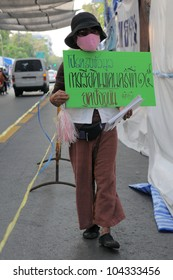 BANGKOK - JANUARY 20: An anti-government protester holds a placard declaring Thai territorial losses to Cambodia at a rally outside Government House on January 20, 2011 in Bangkok, Thailand.