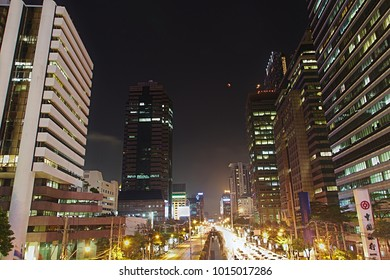 Bangkok - January 31, 2018: A Super Blue Blood Moon rises on the Thai capital's nighttime skyline.