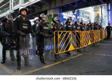 BANGKOK - JANUARY 9: Riot police block an entrance to Sukumvit Road at a 30,000 strong anti government Red Shirt protest at Rachaprasong junction on January 9, 2011 in Bangkok, Thailand.