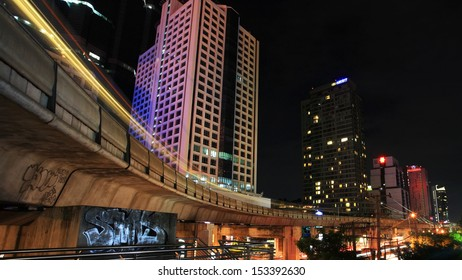 BANGKOK - JUL 07: Light trails on BTS elevated rail at Sathorn business center on July 07, 2012 in Bangkok, Thailand. Elevated rails cover business, resident, and tourist areas by 32 stations.