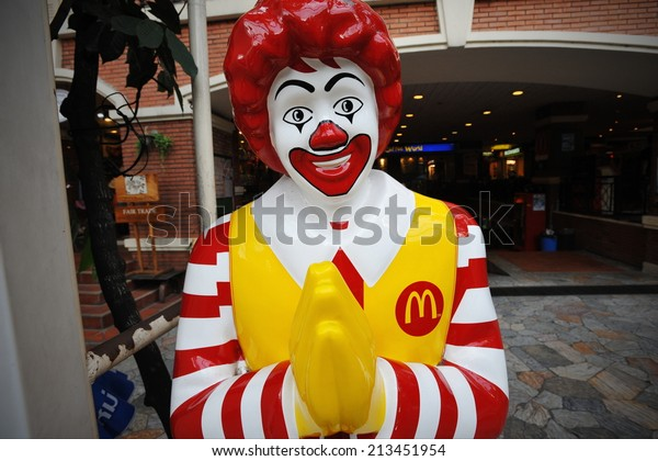 BANGKOK - JULY 11: View of Ronald McDonald in front of a McDonald's outlet in the city centre on July 11, 2013 in Bangkok, Thailand. McDonald's operates in 119 countries with 160 stores in Thailand.