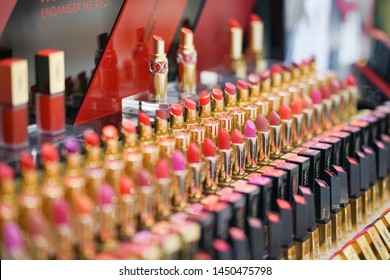 Bangkok - July 13, 2019 : A photo of rows of lipsticks in various shades of red and pink. Yves saint laurent is a French luxury cosmetics and fashion brand. Soft focus on the pink lipstick with logo.