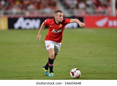 BANGKOK - JULY 13: Tom Cleverley of Man Utd. in action during Singha 80th Anniversary Cup Manchester United vs Singha All Star at Rajamangala Stadium on July 13,2013 in Bangkok, Thailand.